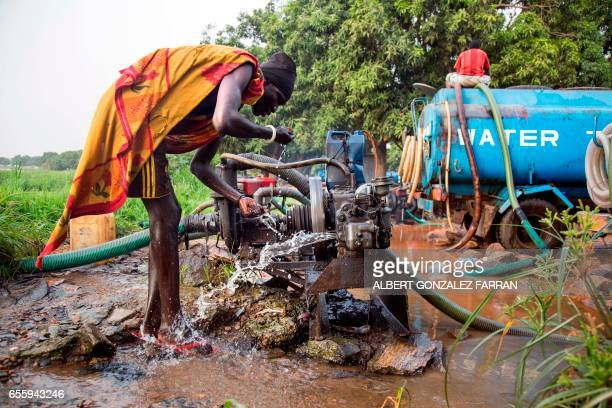 A man drinks water directly pumped from the Nile river on March 21 2017in Juba South Sudan to be distribute to local residents for drinking...