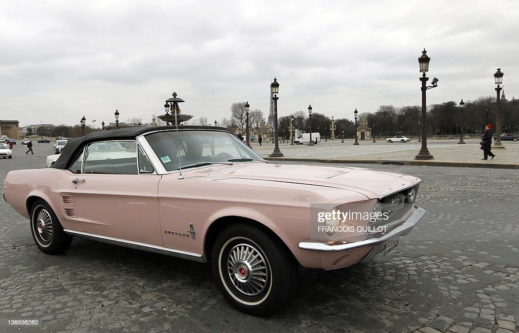 a man drives a ford mustang during a classic cars meeting. Black Bedroom Furniture Sets. Home Design Ideas
