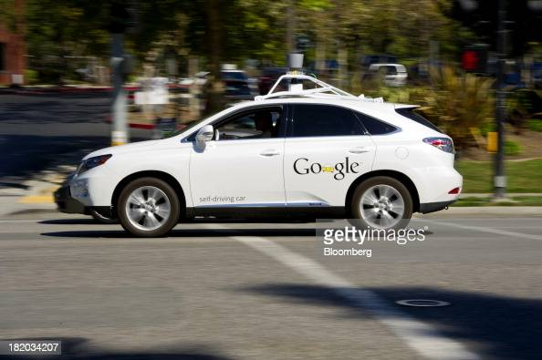 A man drives a Google Inc selfdriving car in front of the company's headquarters in Mountain View California US on Friday Sept 27 2013 Google is...