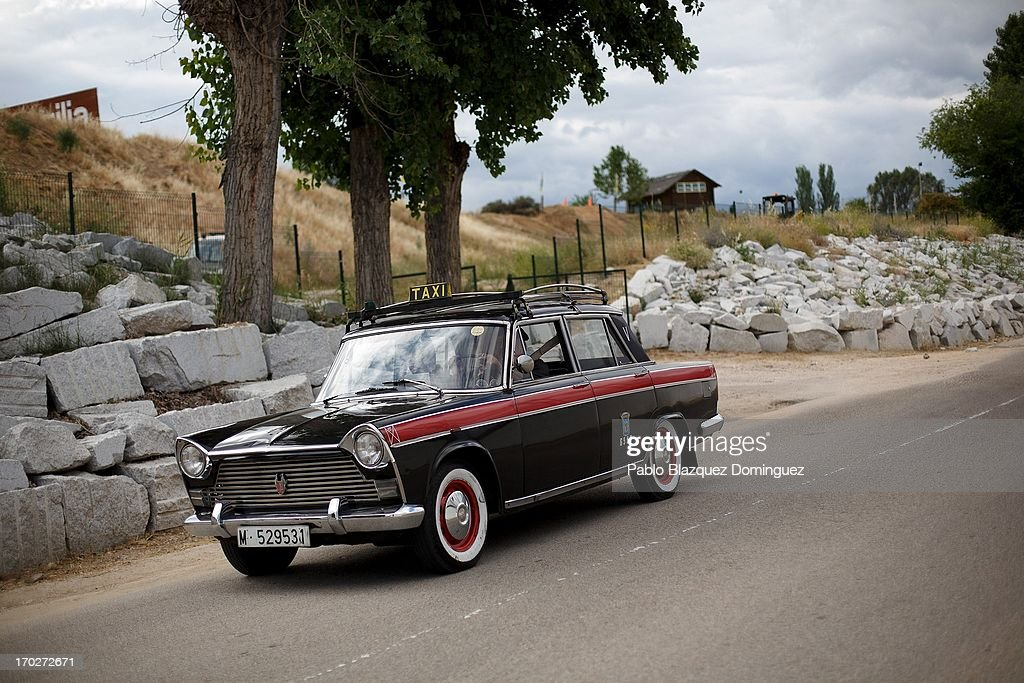A man drives a Taxi Seat 1500 at the Jarama Circuit on June 9, 2013 in Madrid, Spain. The Jarama Vintage Festival seeks to revive the 1960s, 70s and 80s attracting classic cars and motorbikes against a background of public orientated activities and shows.