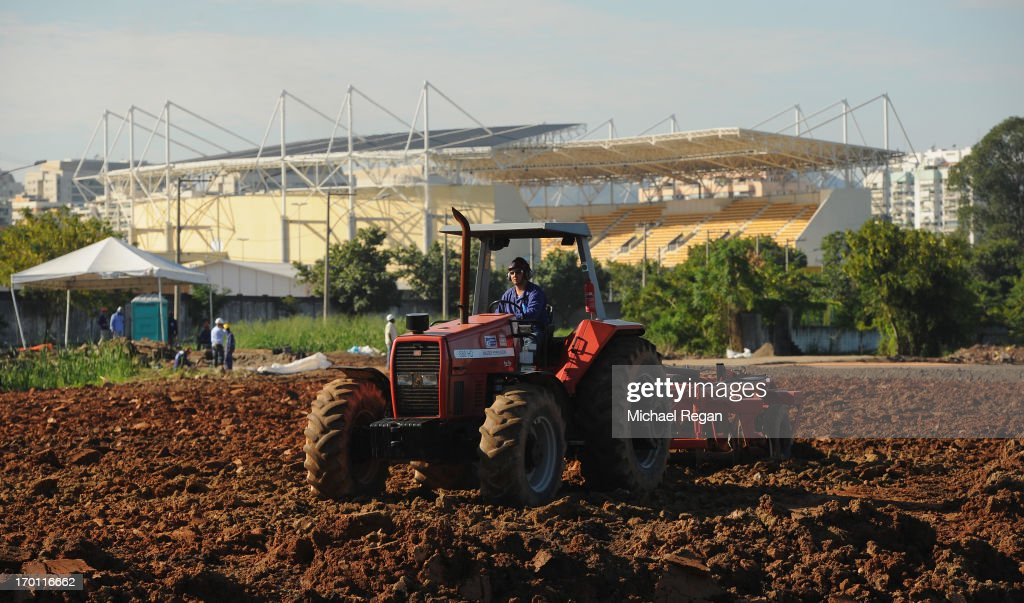 A man drives a tractor at the site of the Olympic Park in Barra as preparations continue ahead of the 2016 Olympic Games on June 6, 2013 in Rio de Janeiro, Brazil.