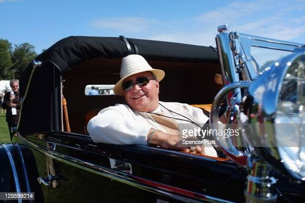 A man drives his antique car during an auto show of rare and luxury vehicles on September 18 2011 in Westport Connecticut Despite some of the poorest...