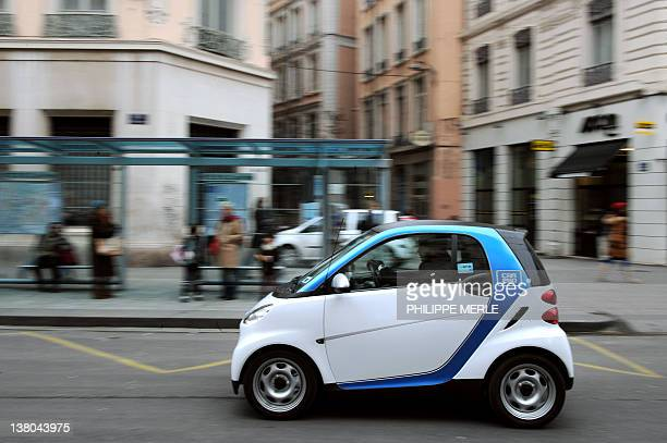 A man drives Smart fortwo coupe pure car2go edition with a Solar roof on February 1 2012 in Lyon during the presentation and launching of the...