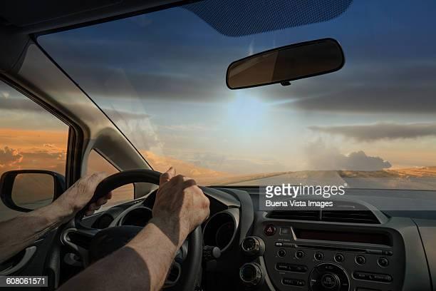 Man driving a car in the desert