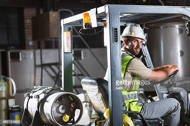 Man driving a forklift in warehouse