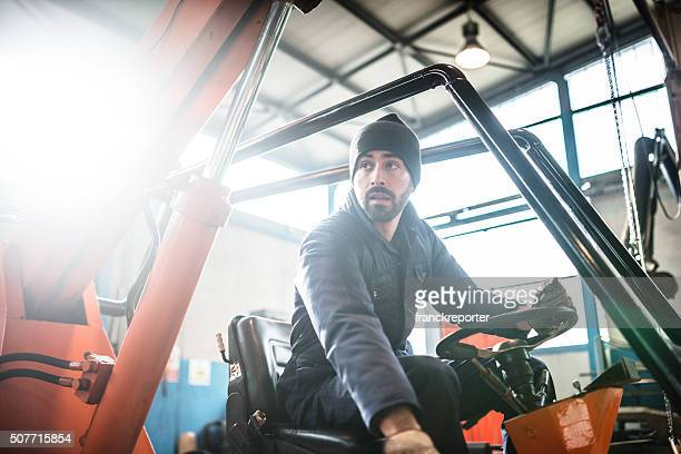 man driving a forklift