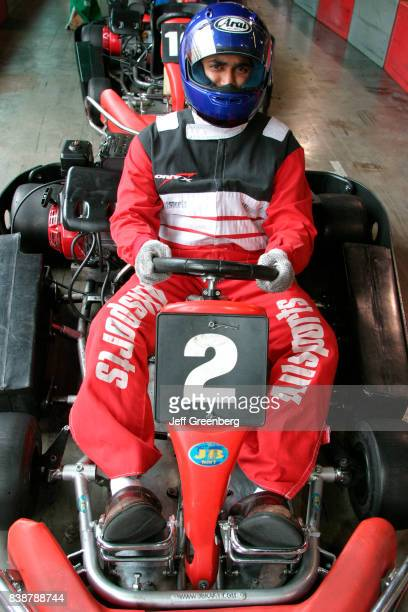 A man driving a go kart at the Grand Prix Allsports Hi Speed Indoor Kart Racing