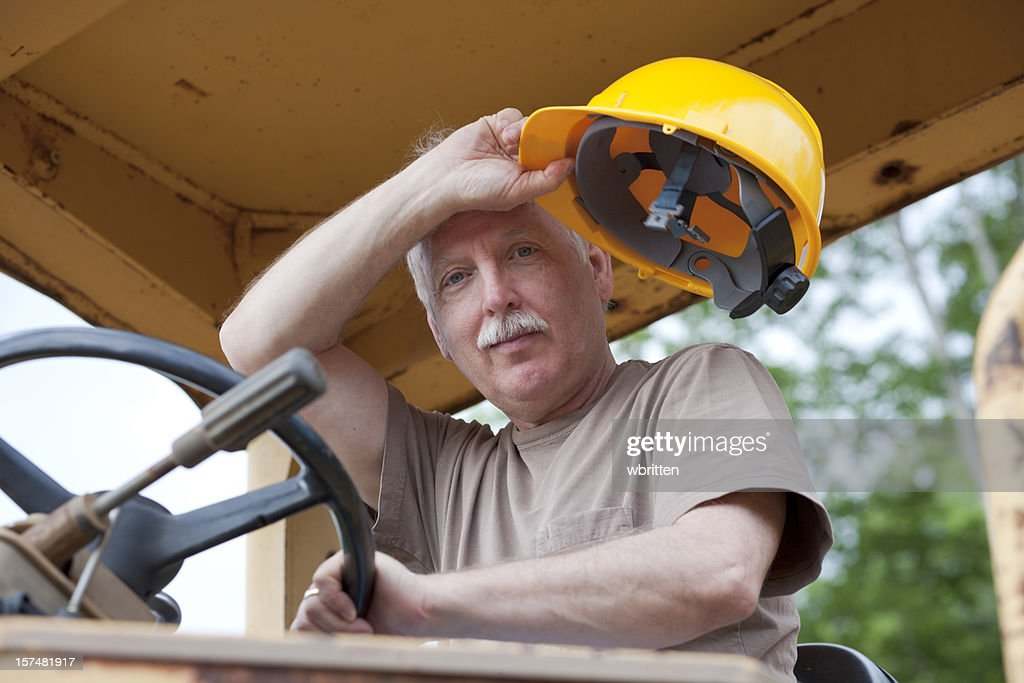 Man driving bulldozer at construction site  (XXL) : Stock Photo