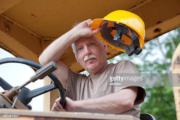 Man driving bulldozer at construction site  (XXL)