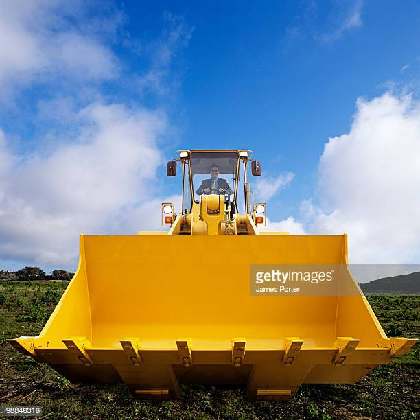 Man driving bulldozer