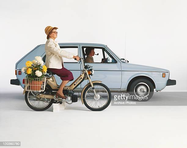 Man driving car and woman riding motorbike on white background