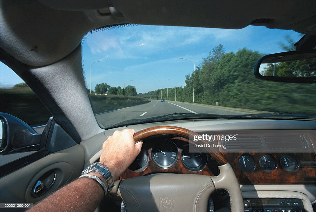 Man driving car, close-up : Stock Photo