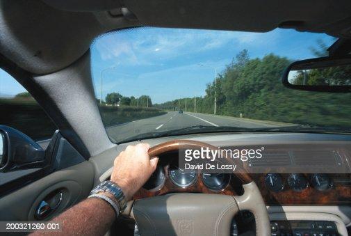 Man driving car, close-up : Foto de stock