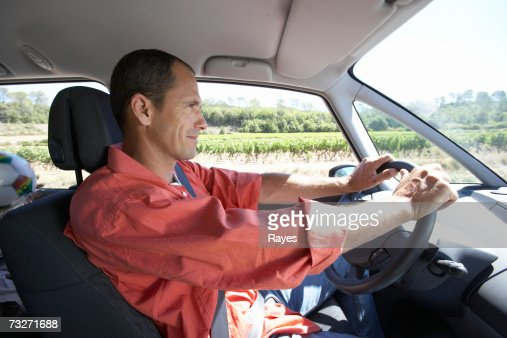 man driving car in countryside side view stock foto getty images. Black Bedroom Furniture Sets. Home Design Ideas