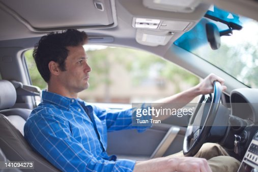 Man driving car : Stock Photo