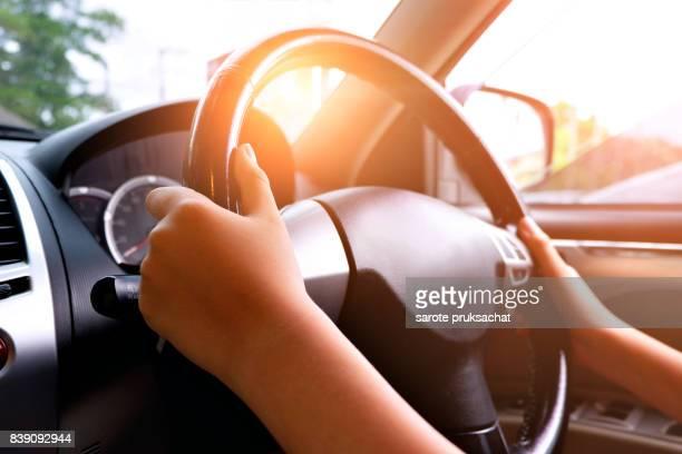 Man driving car.