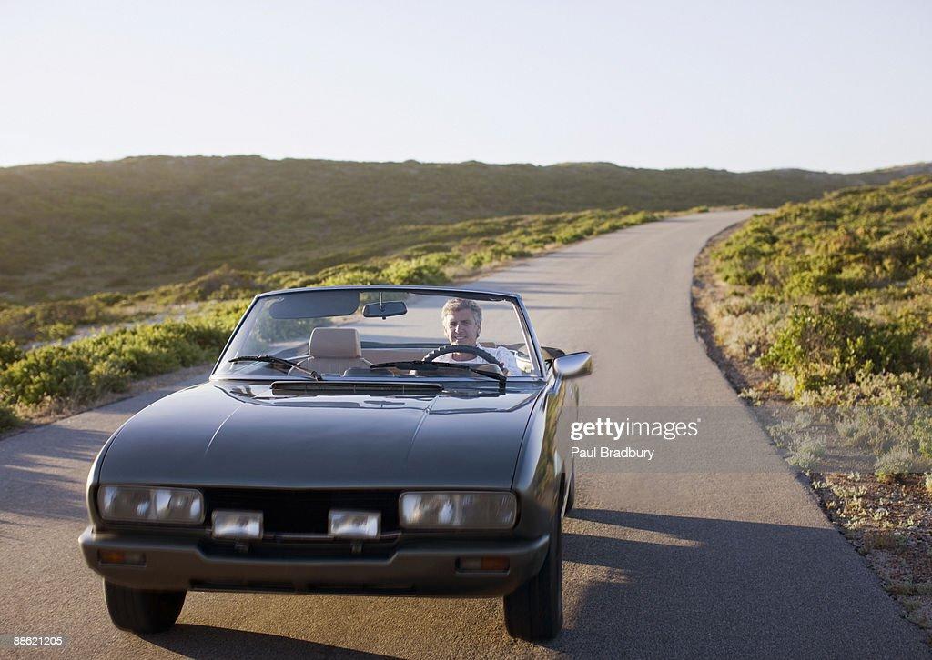Man driving convertible : Stock Photo