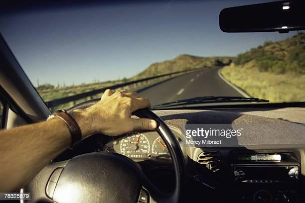 Man driving down winding road