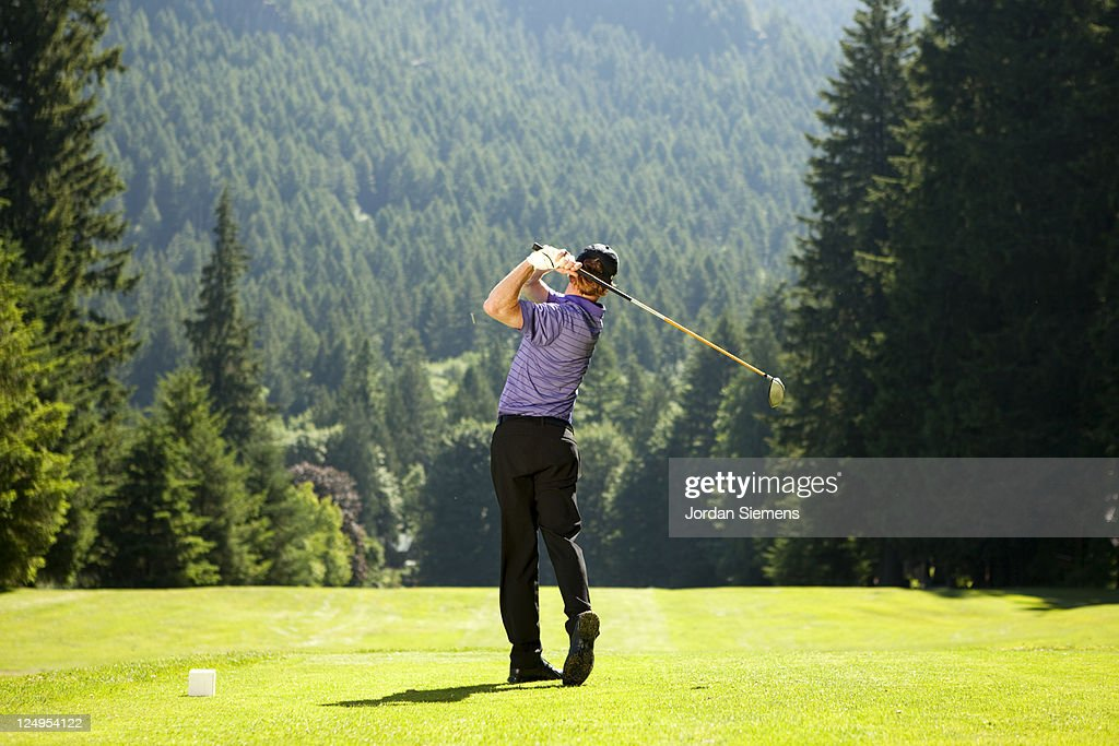 A man driving his golf ball. : Stock Photo
