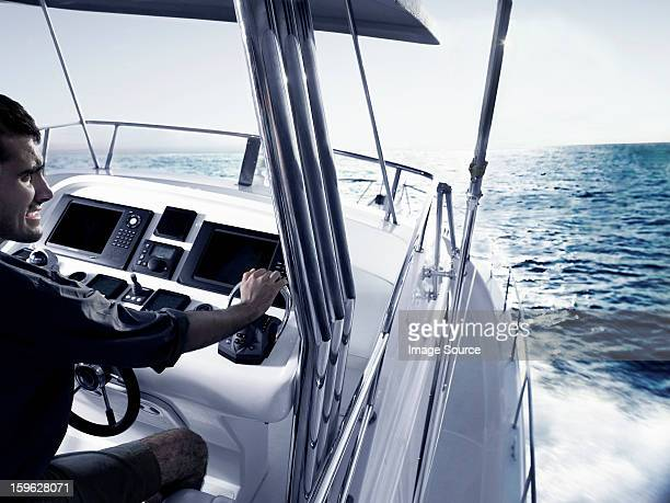 Man driving power boat
