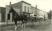 Man Driving Wagon Down Street