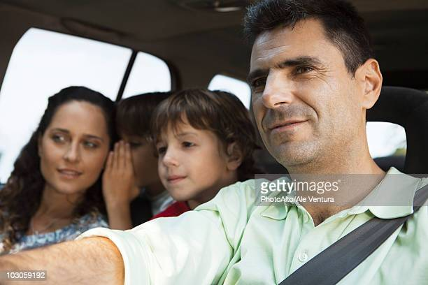 Man driving with his family