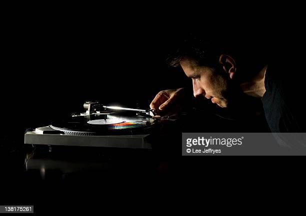 Man dropping needle on vinyl record