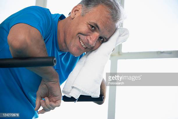 Man drying sweat from his face