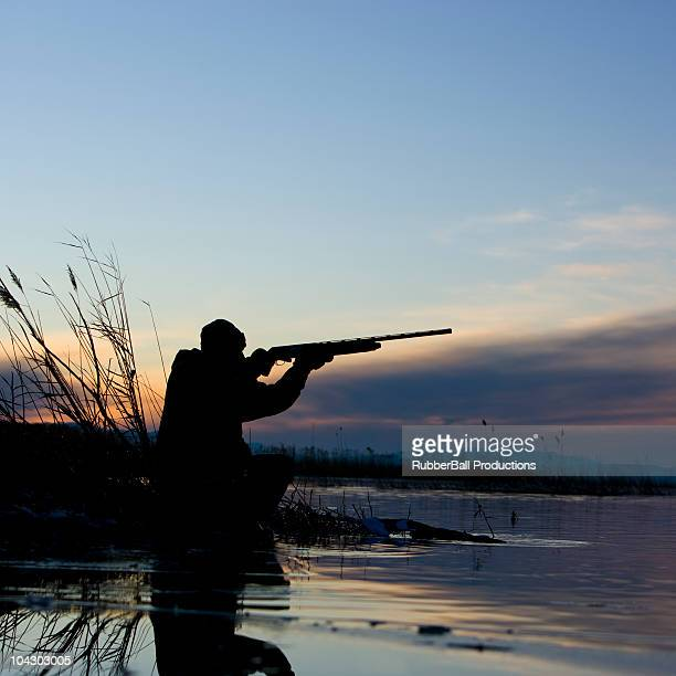 man duck hunting