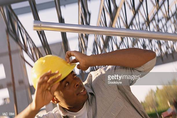 Man ducking from steel pipe