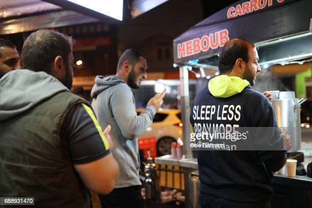 A man ears a 'Sleep less pray more #ramadan' hoody during a street festival in the southwestern suburb of Lakemba on May 27 2017 in Sydney Australia...