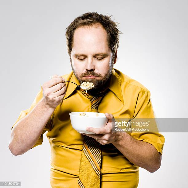 man eating a bowl of cereal