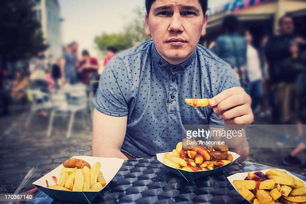 Man eating a scampi and chips takeaway