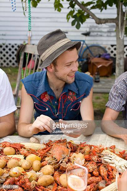 Man eating at crab boil