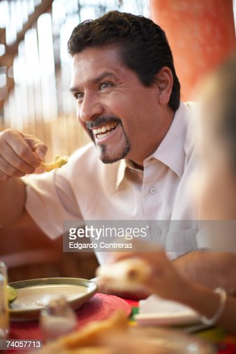 Man eating at restaurant : Stock Photo