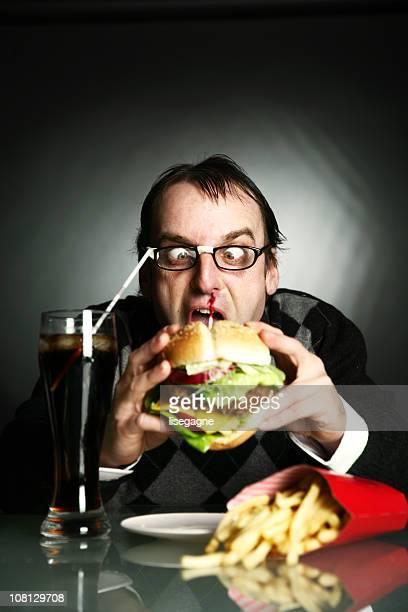 Homem comer grande Burger