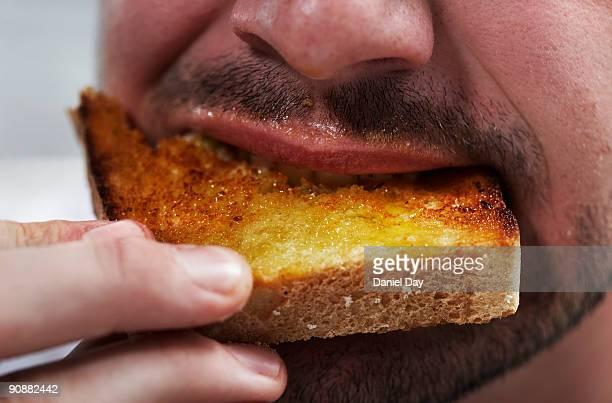 Man eating bread