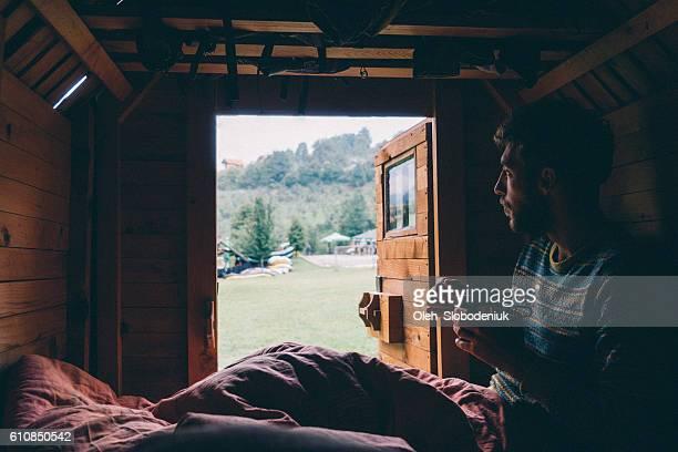 Man eating breakfast in tiny house
