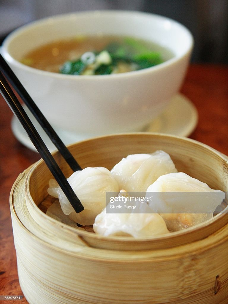 Man eating Chinese food with chopsticks : Stock Photo