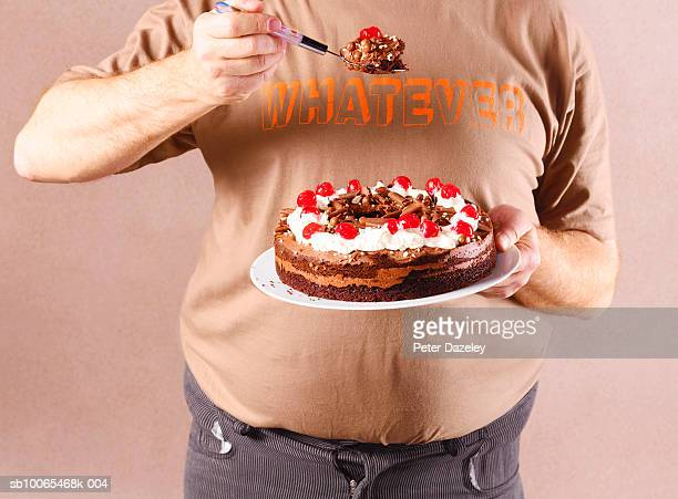 Man eating chocolate cake, close-up