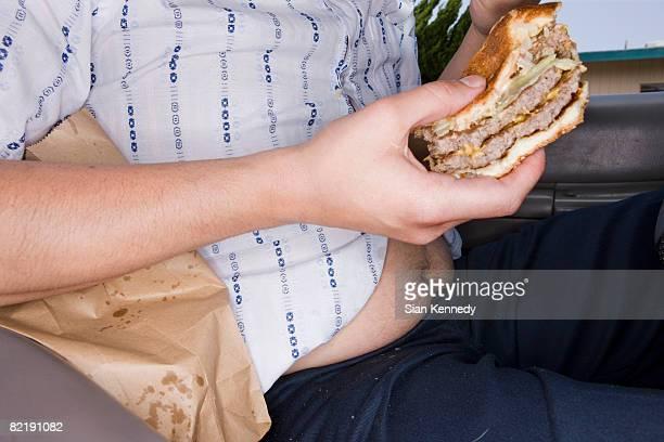 Man eating fast food in his car