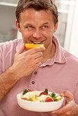 Man eating fresh fruit