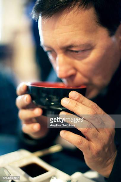 Man eating miso soup