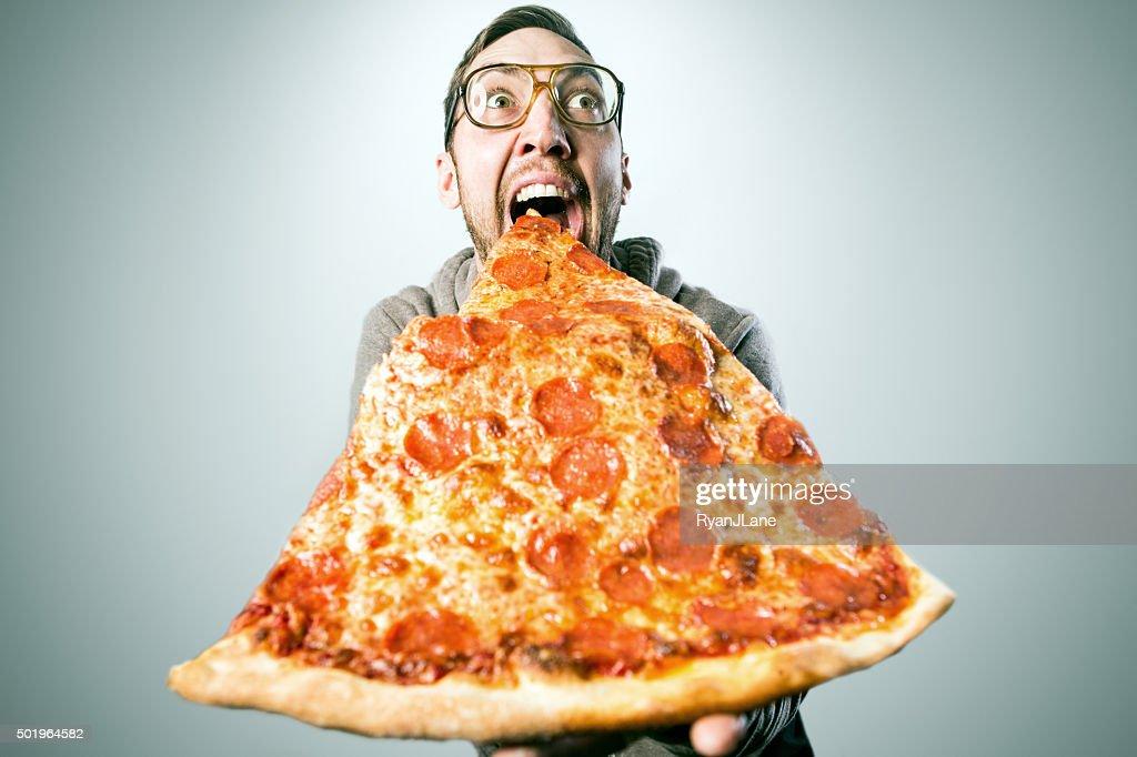 Man Eating Oversized Pizza Slice : Stock Photo