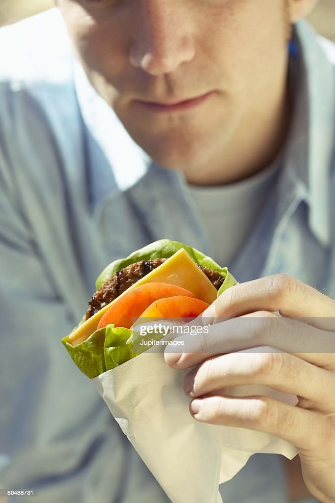 Man eating protein burger