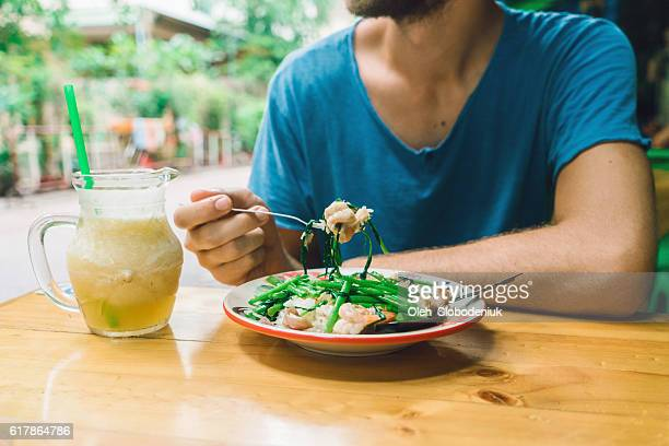 Man eating rice  in cafe in Bangkok