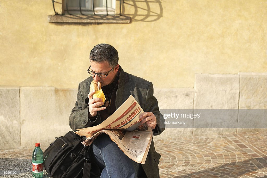 Man eating sandwich : Stock Photo