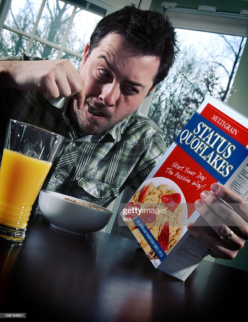 Man Eating Status Quo-Flakes for Breakfast : Stock Photo
