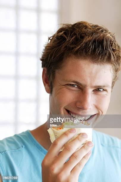 Man Eating Wrap