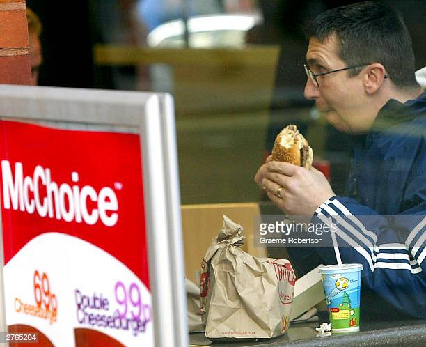 A man eats a meal in a McDonalds restaurant on November 27 2003 in London Representatives for fast food giant McDonalds and fizzy drinks group...